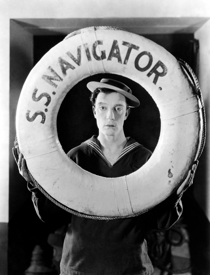 1924: Promotional portrait of actor and director Buster Keaton (1895 - 1966) wearing a sailor suit and holding a life preserver from the film, 'The Navigator,' directed by Keaton and Donald Crisp.